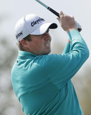**CORRECTS LAST NAME TO PETTERSSON** Shane Lowry of Ireland tees off the fourth hole in the second round of play against Carl Pettersson of Sweden during the Match Play Championship golf tournament, Friday, Feb. 22, 2013, in Marana, Ariz. (AP Photo/Ross D. Franklin)