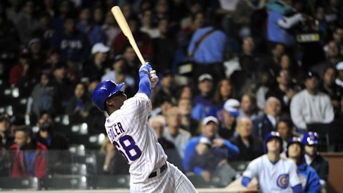 Chicago Cubs' Jorge Soler bats against the Cincinnati Reds in a baseball game, Wednesday, Sept. 17, 2014 in Chicago.  (AP Photo/David Banks)