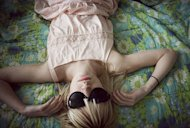 12-girl-sunglasses-bed_sm.jpg