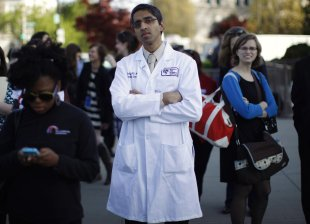 Doctor Vivek Murthy stands among other bystanders during the first day of legal arguments over the Affordable Care Act outside the Supreme Court in Washington in this March 26, 2012 file photo. The U.S. Senate confirmed the long-delayed nomination of Murthy for surgeon general December 15, 2014,  as Democrats pushed to approve some of President Barack Obama's stalled choices for government posts before Republicans take power in Congress next year (REUTERS/Jason Reed/Files)