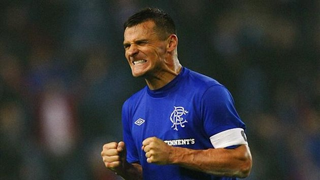 Rangers' team captain and goalscorer Lee McCulloch celebrates as the final whistle is blown in their Scottish Communities League Cup soccer against Motherwell at Ibrox Stadium in Glasgow, Scotland September 26, 2012.