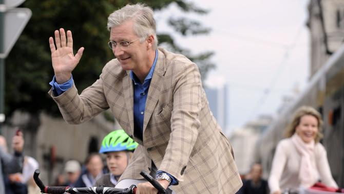 """Belgium's Prince Emmanuel, King Philippe and Queen Mathilde ride their bicycles in central Brussels during """"Car Free Sunday"""""""