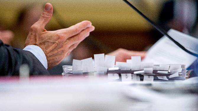 Tabs labeling a variety of talking points are visible on a binder in front of Secretary of State John Kerry as he testifies on Capitol Hill in Washington, Tuesday, July 28, 2015, before the House Foreign Affairs Committee hearing on the Iran Nuclear Agreement. Kerry pitched the administration's controversial nuclear deal with Iran before a skeptical House Foreign Affairs Committee on Tuesday, pushing back against the allegation it would ease crippling sanctions forever in exchange for temporary concessions on weapons development. (AP Photo/Andrew Harnik)