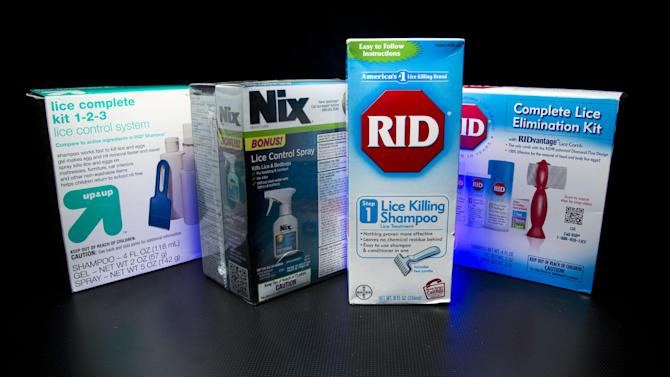 """Over the counter products for controlling head lice are photographed in Washington, Monday, Nov. 4, 2013. Some parents are scratching their heads over less restrictive head lice policies that allow children with live bugs in their hair to return to the classroom for the rest of the day. Some school nurses are no longer sending home """"lice notes"""" to parents of other children in the classroom. The policy shift is designed to help keep children from missing class, shield children with lice from embarrassment and protect their privacy. (AP Photo/J. David Ake)"""