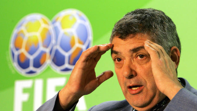 "FILE - In this Friday, June 30, 2006 file photo Angel Maria Villar Llona, FIFA Vice President and Chairman of the Referees Committee gestures during a press conference in Berlin. FIFA anti-corruption adviser Mark Pieth believes European officials are blocking reforms in world football to further their own careers. Pieth told the Associated Press that he looked for influential UEFA members to show more independence as their president Michel Platini _ the favorite to lead FIFA in 2015 _ makes ""unanimous declarations"" on their behalf. (AP Photo/Franka Bruns, File)"