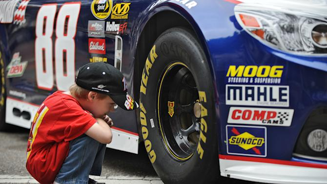 Daniel Clark, 6, wearing a Clint Bowyer t-shirt gets an up close look at the new Gen6 Chevrolet SS No 88 car of Dale Earnhardt Jr. during NASCAR day Tuesday, Feb. 12, 2013, in Jacksonville, Fla.  The event is part a multi-city media blitz introducing the 2013 NASCAR Sprint Cup Series Chevrolet SS, Ford Fusion and Toyota Camry race cars.  (AP Photo/The Florida Times-Union, Bob Mack) MAGS OUT. TV OUT
