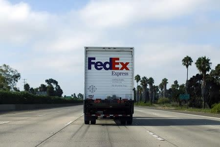 Federal Express truck makes its way down a freeway in San Diego, California