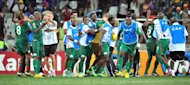 Burkina Faso&#39;s players celebrate beating Ghana on penalties on February 6, 2013 in Nelspruit. Burkina Faso drew with Nigeria in a Group C opener before whipping Ethiopia, holding title-holders Zambia and edging Togo through an extra-time goal and Ghana on penalties