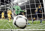 Ukrainian forward Andrei Shevchenko scores past Swedish goalkeeper Andreas Isaksson during the Euro 2012 football match Ukraine vs Sweden. Hosts Ukraine won 2-1