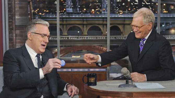 """In this photo provided by CBS, talk show host Keith Olbermann, left, chats with host David Letterman on the set of the """"Late Show with David Letterman,"""" Tuesday April 3, 2012 in New York. (AP Photo/CBS, Jeffrey R. Staab) MANDATORY CREDIT; NO ARCHIVE; NO SALES; FOR NORTH AMERICAN USE ONLY"""