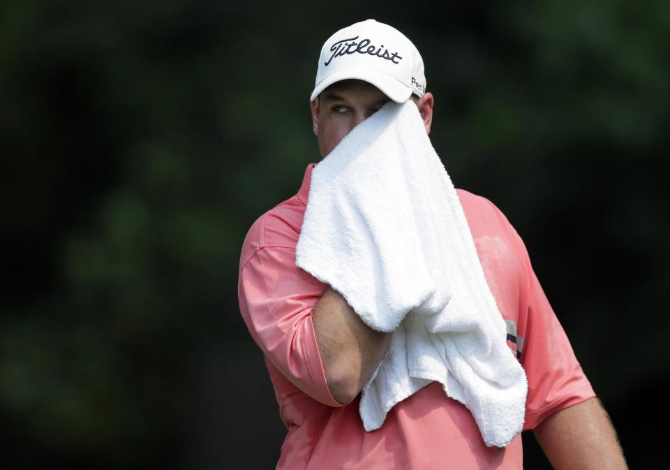 Brendon de Jonge wipes sweat from his face as he walks on the 13th tee box during the second round of the AT&T National golf tournament at Congressional Country Club in Bethesda, Md., Friday, June 29, 2012. (AP Photo/Patrick Semansky)