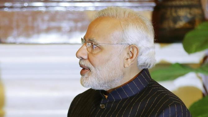"Indian Prime Minister Modi, wearing a dark pinstripe suit repeatedly embroidered with the words ""Narendra Damodardas Modi"", meets with U.S. President Barack Obama in New Delhi"