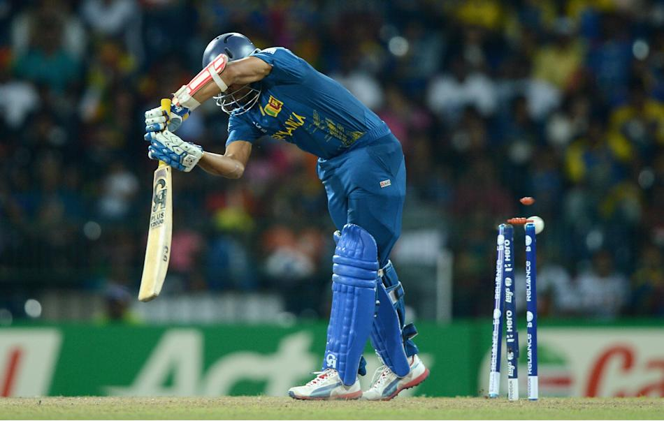 COLOMBO, SRI LANKA - OCTOBER 07: Tillakaratne Dilshan of Sri Lanka is bowled by Ravi Rampaul of the West Indies during the ICC World Twenty20 2012 Final between Sri Lanka and the West Indies at R. Pre