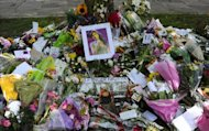 Flowers, pictures and messages are left in tribute to late soul music and pop star Amy Winehouse, near the house in north London where her body was found the previous day, on July 24, 2011. A second inquest into the death of Winehouse confirmed Tuesday that she died of accidental alcohol poisoning.
