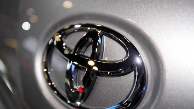 FILE - This March 31, 2010 file photo shows the Toyota logo on a car at the New York International Auto Show in New York. Toyota Motor Corp. officials say the company has settled what was to be the first in a group of hundreds of pending wrongful death and injury lawsuits involving sudden, unintended acceleration by Toyota vehicles. (AP Photo/Seth Wenig, File)