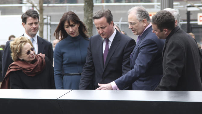 British Prime Minister David Cameron, center, and his wife Samantha, third from left, pay their respects to Katherine Wolf alongside her husband Charles, second from right, during a visit to the National September 11 Memorial,  Thursday, March 15, 2012 in New York.  (AP Photo/Mary Altaffer, Pool)
