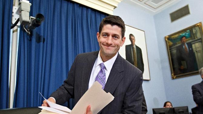 FILE In this June 1, 2012 file photo, Republican vice presidential candidate,  Rep. Paul Ryan, R-Wis. is seen on Capitol Hill in Washington. Paul Ryan's fastidious commitment to fitness and healthy living can be traced to 1986. That's when he found his father dead of a heart attack in the family's Wisconsin home, becoming the latest in a long line of men in the family to die prematurely. Today, Ryan is 42. He boasts of body fat between just 6 and 8 percent. He doesn't eat sweets _ even on his birthday. He holds early morning work outs in the House gym for colleagues. And he favors a high-intensity workout called P90X. The youthful Ryan's intensity _ and the story behind it _ has been in the spotlight since Romney announced his running-mate selection last weekend.  (AP Photo/J. Scott Applewhite, File)