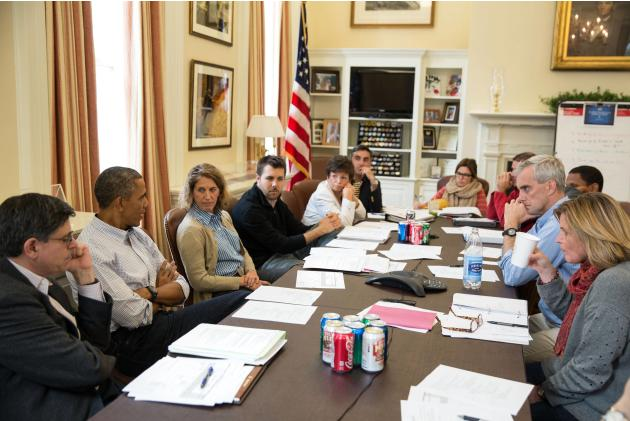 U.S. President Barack Obama meets with senior staff at the White House in Washington