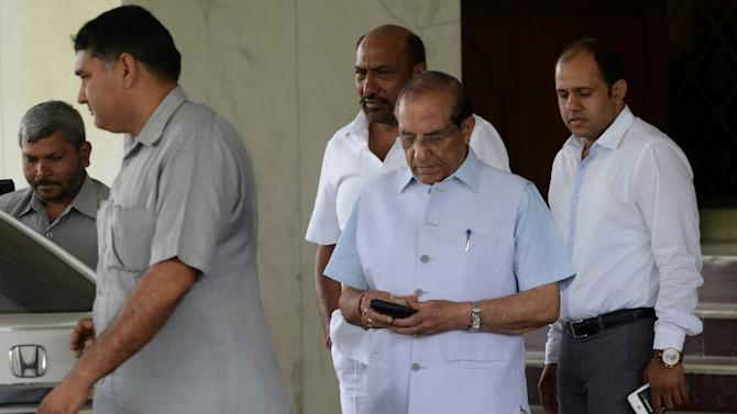 Vijay Kumar Malhotra (C), Indian Olympic Association member, leaves a hotel after a meeting in New Delhi on April 27, 2015