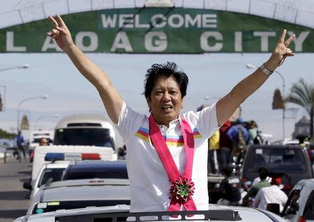 "Senator Ferdinand ""Bongbong"" Marcos, son of late dictator Ferdinand Marcos who is now running for Vice-President gestures during a motorcade campaign at Laoag city"