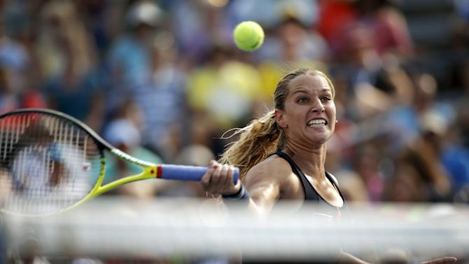 Cibulkova hits a return to Bouchard of Canada during their match at the U.S. Open Championships tennis tournament in New York
