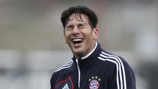 Munich's Claudio Pizarro of Peru laughs during a training session in Munich, southern Germany, on Monday, April 1, 2013. Bayern Munich will face Juventus Turin in a first leg Champions League quarterfinal soccer match on Tuesday. (AP Photo/Matthias Schrader)