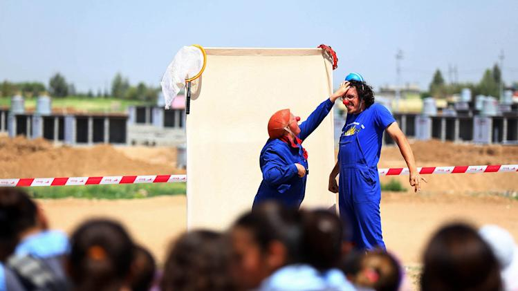 Clowns entertain Syrian refugee children at the Quru Gusik refugee camp on the outskirts of Arbil