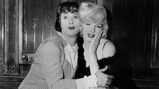 """FILE - In this 1959 file photo provided by United Artists, Tony Curtis, left, and Marilyn Monroe are shown in the hilarious, milestone comedy, """"Some Like It Hot,""""  produced, directed, and co-scripted by Billy Wilder. (AP Photo, File)"""