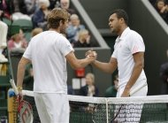 Jo-Wilfried Tsonga of France is congratulated by Mardy Fish of United States, left, following a fourth round singles match at the All England Lawn Tennis Championships at Wimbledon, England, Tuesday, July 3, 2012. (AP Photo/Sang Tan)