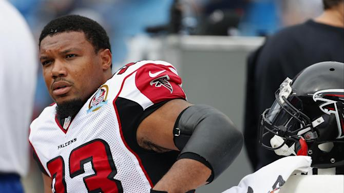 FILE - In this Dec. 9, 2012 file photo, Atlanta Falcons running back  Michael Turner (33) sits on the bench before an NFL football game against the Carolina Panthers in Charlotte, N.C. The  Falcons have released Turner, defensive end John Abraham and cornerback Dunta Robinson The moves were announced Friday, March 1, 2013, by a team that came up just short of the Super Bowl.  (AP Photo/Bob Leverone, File)
