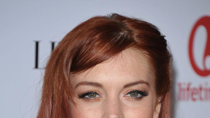 """Actress Lindsay Lohan attends a dinner celebrating the premiere of """"Liz & Dick"""" at the Beverly Hills Hotel on Tuesday, Nov. 20, 2012, in Beverly Hills, Calif. (Photo by John Shearer/Invision/AP)"""