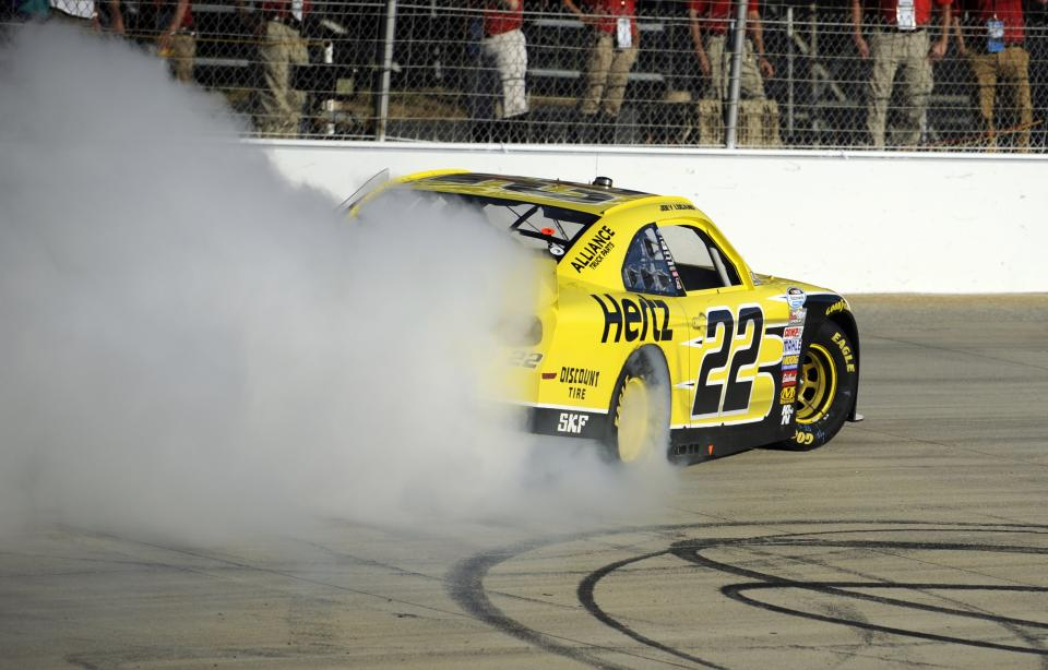 Joey Logano performs a burnout after he won the NASCAR Nationwide Series auto race, Saturday, Sept. 28, 2013, at Dover International Speedway in Dover, Del. (AP Photo/Nick Wass)