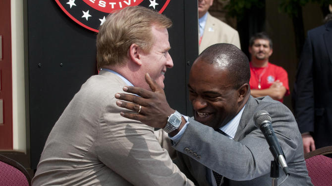 NFL Comissioner Roger Goodell, left, and NFLPA Executive Director DeMaurice Smith, congratulate each other after signing their collective bargaining agreement at the Pro Football Hall of Fame in Canton, Ohio, Friday, Aug. 5, 2011. (AP Photo/Phil Long)