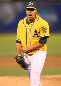 A's signal surrender by shipping Gonzalez to Nats