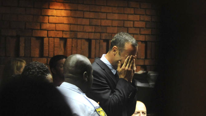 Athlete Oscar Pistorius weeps in court in Pretoria, South Africa, Friday, Feb 15, 2013, at his bail hearing in the murder case of his girlfriend Reeva Steenkamp.   Oscar Pistorius arrived at a courthouse Friday, for his bail hearing in the murder case of his girlfriend as South Africans braced themselves for the latest development in a story that has stunned the country. The Paralympic superstar was earlier seen leaving a police station in a dark suit with a charcoal gray jacket covering his head as he got into a police vehicle. Model Reeva Steenkamp was shot and killed at Pistorius' upmarket home in an eastern suburb of the South African capital in the predawn hours of Thursday. (AP Photo/Antione de Ras - Independent Newspapers Ltd South Africa) SOUTH AFRICA OUT