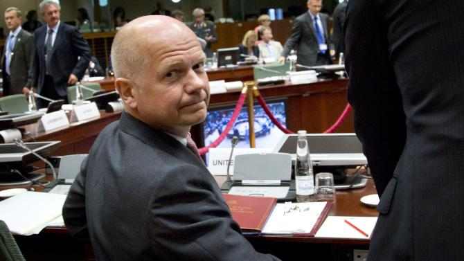 Britain's Foreign Minister William Hague looks back toward photographers during an emergency meeting of EU foreign ministers at the EU Council building in Brussels on Wednesday, Aug. 21, 2013. EU foreign ministers are seeking to forge a joint response to the crisis in Egypt by looking for ways to end the violence and return to negotiations. (AP Photo/Virginia Mayo)