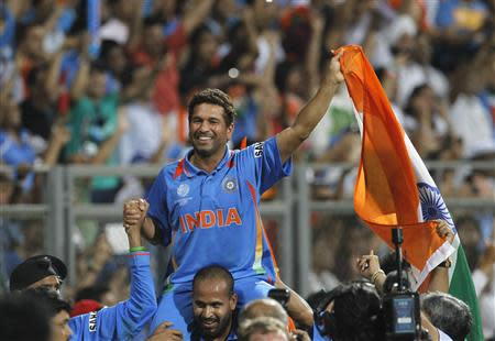 File photo of India's Tendulkar carried by his teammate Pathan after they beat Sri Lanka in the ICC Cricket World Cup final match in Mumbai