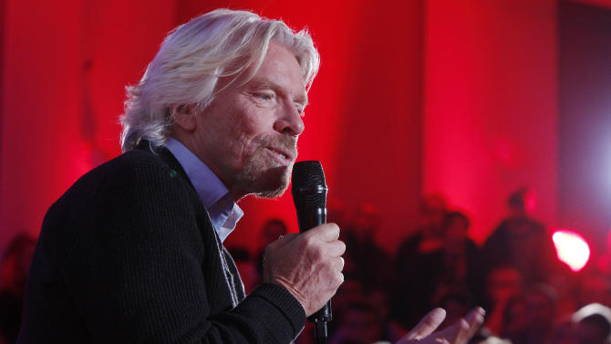 "Virgin Group owner, British billionaire Richard Branson tells students packing a hall at Warsaw University that they need to be ""passionate about whatever you are doing in life"" to achieve success during a launch of Virgin Academy, a project to help young Poles start their businesses in Warsaw, Poland, on Wednesday, Oct. 24, 2012.  (AP Photo/Czarek Sokolowski)"