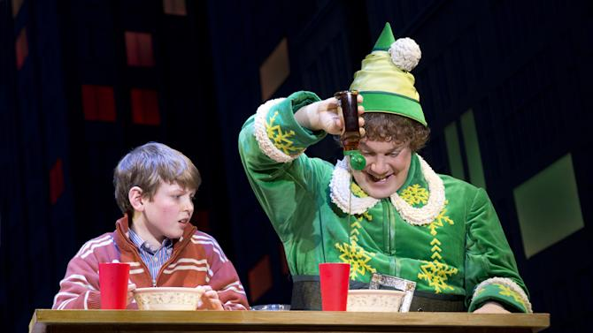 """This theater image released by The Hartman Group shows Mitchell Sink, left, and Jordan Gelber during a performance of the musical """"Elf,"""" in New York. (AP Photo/The Hartman Group, Joan Marcus)"""