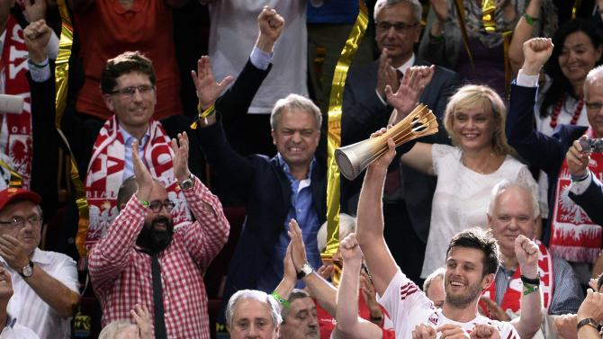 Poland's Winiarski holds up trophy after winning Volleyball Men's World Championship in Katowice