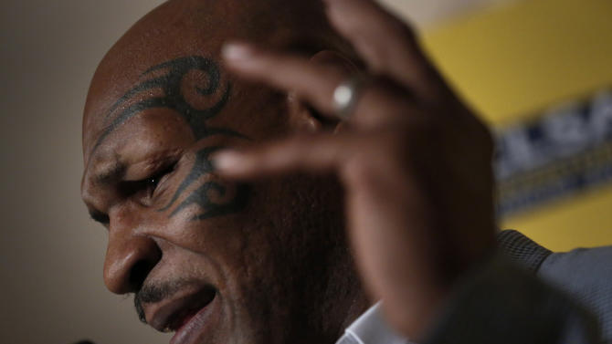 FILE - In this Sept. 12, 2012 file photo, former heavyweight boxing champion Mike Tyson speaks a press conference at the 19th Credit Lyonnais Securities Asia (CLSA) investors Forum at a hotel in Hong Kong. In a reversal, Mike Tyson has been denied entry to the country whose indigenous Maori people he says inspired his facial tattoo. New Zealand authorities on Wednesday, Oct. 3, 2012 canceled an entry visa for the former heavyweight boxing champion and convicted rapist, days after the prime minister spoke out against his planned visit. (AP Photo/Vincent Yu, File)