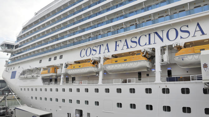 The euro 510-million ($670-million) Costa Fascinosa cruise ship, with a capacity of 3,800 passengers is now the largest Italian-flagged cruise ship, is seen on the occasion of its unveiling in Venice, Italy, Saturday, May 5, 2012. Italian cruise line Costa Crociere SpA unveiled new safety measures Saturday following the deadly grounding of its ship off Tuscany, saying it will now have real-time tracking of its ships' routes and will impose limits on its captains' absolute authority. The measures seek to respond to many of the problems involved in the Costa Concordia disaster: The ship rammed into a reef Jan. 13 after the captain veered off course in an apparent stunt, and then capsized off the island of Giglio, killing 32 people. (AP Photo/Luigi Costantini)