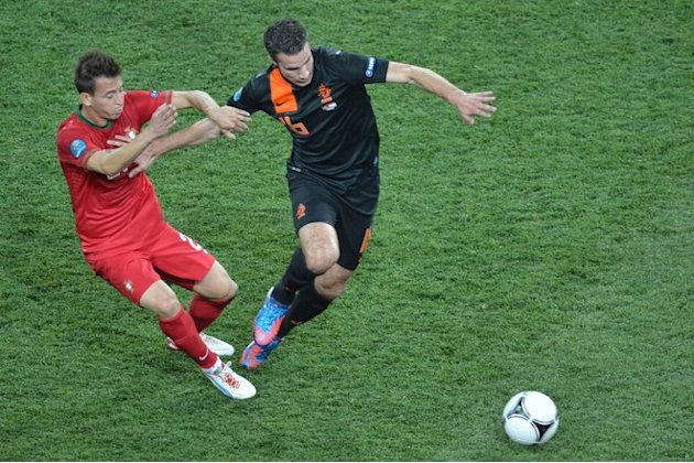 Dutch Forward Robin Van Persie (R) Holds Off Portuguese Defender Joao Pereira   AFP PHOTO / SERGEI SUPINSKYSERGEI AFP/Getty Images