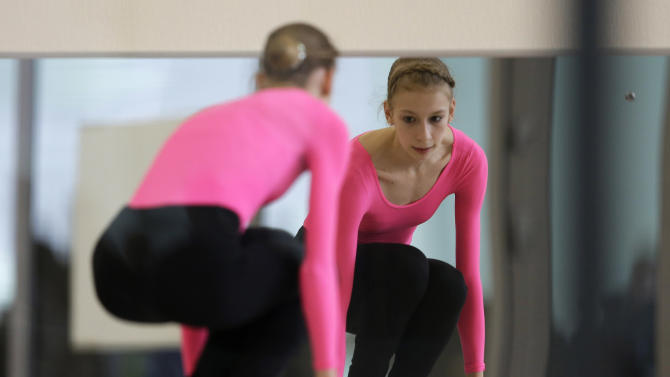 Polina Edmunds of the United States jumps rope before a practice session at the figure stating practice rink at the 2014 Winter Olympics, Monday, Feb. 17, 2014, in Sochi, Russia. (AP Photo/Darron Cummings)