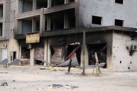 A damaged building is pictured after clashes between rival militias, in an area at Alswani road in Tripoli