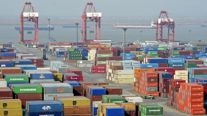 In this photo taken on Saturday, Dec. 10, 2011, a truck leaves a port in Nanjing in east China's Jiangsu province. During a forum to commemorate the 10-year anniversary of China's accession to the World Trade Organization on Sunday, Chinese President Hu Jintao said China doesn't intentionally pursue a large trade surplus and it will focus on expanding imports in the coming years.  (AP Photo) CHINA OUT