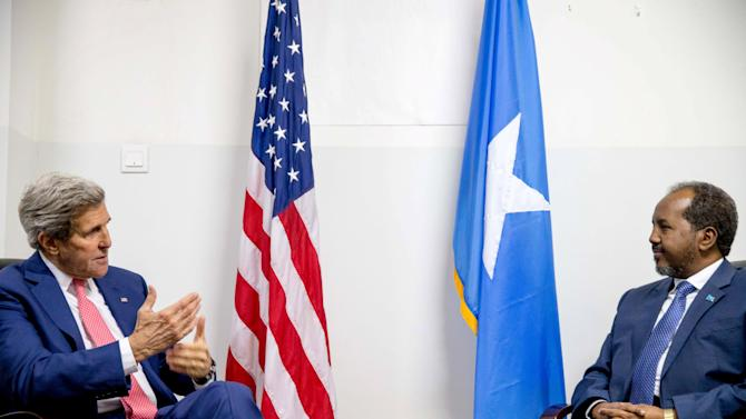 U.S. Secretary of State Kerry meets with Somalia's President Mohamud at the airport in Mogadishu