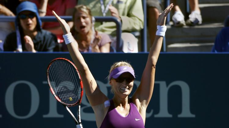 Mirjana Lucic-Baroni of Croatia raects after defeating Simona Halep of Romania during their match at the 2014 U.S. Open tennis tournament in New York