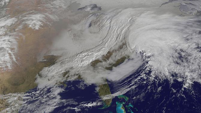 Snowstorm hits NYC, Boston; 1 to 3 feet feared