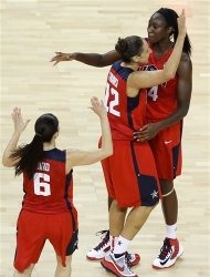 United States' Tina Charles, top, celebrates with teammates Diana Taurasi, center, and Sue Bird, bottom, during a women's basketball semifinal game against Australia at the 2012 Summer Olympics, Thursday, Aug. 9, 2012, in London. (AP Photo/Victor R. Caivano)